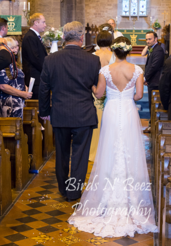 father walking down the isle with bride wedding